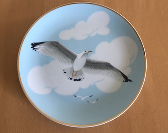 Darling vintage decorative plate features seagulls in blue sky with white clouds made in Japan gold rim ready to hang in Old Florida home!