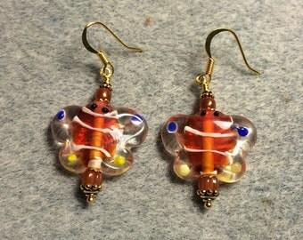 Orange and blue lampwork butterfly bead earrings adorned with dark orange Czech glass beads.