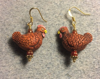 Brown orange ceramic chicken bead earrings adorned with brown orange Czech glass beads.
