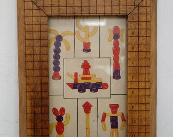 Vintage toy graphic with handmade 'Ingento' maple paper shear frame.