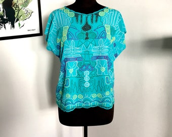 80s vintage green teal embroidered cut work tunic short sleeve blouse Bali Egyptian pattern embroidery cut outs