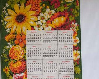 Vintage Tea Towel Calendar with yellow and orange flowers - 1973 Kitchen Towel