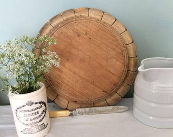 Lovely old circular vintage pine Bread Board in the shape of a flower.
