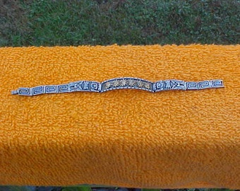 Heavy sterling bracelet with aztec symbols-sun gods with gold inlay