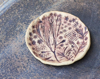 20% off - Small stoneware serving plate with floral imprints - Unglazed