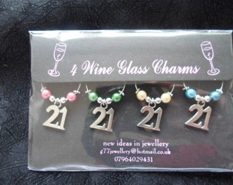 21st birthday Gifts under a tenner 4 x  tibettan silver 21s with coloured beads on a board
