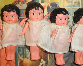 Dionne Quintuplets celluloid dolls, with child made blankets and 7 calenders of the 5 girls as they grow up. 1 is missing the sm calender