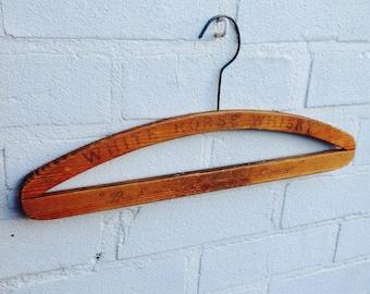 Vintage wooden coat hanger 'White Horse Whiskey'