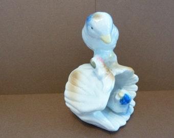 Figurine of Momma Bird Looking Over Baby Bird, in, Hollow Log