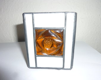 Stained glass candle holder.