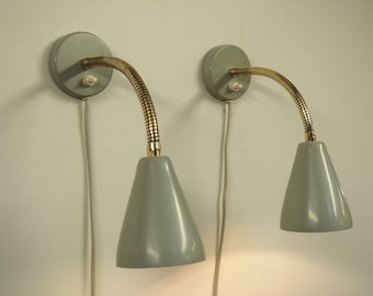 Nice pair of grey mid century modern sconces from the Danish manufacturer, 1960s