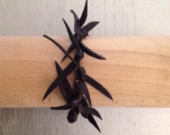 Original bracelet black leather on gray string TOXIK