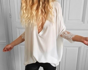 White sweater with v-neck and long sleeves
