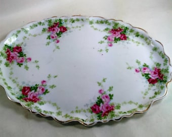 "Vintage Oblong China Platter/9"" by 12.5"" Long/Ivory with Red/Pink Roses And Green Leaves With Gold Trim/Much Of Trim Is Worn Off/ Used (S)"