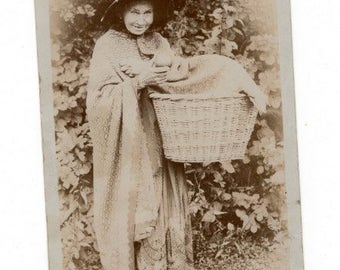 Interesting rppc of old woman and a basket of apples