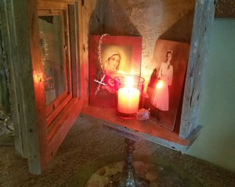 Display cabinet, shrine, nicho, altar, grotto, memorial.