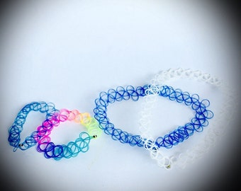 vintage tattoo jewelry two choker necklaces and two bracelets blue white and rainbow