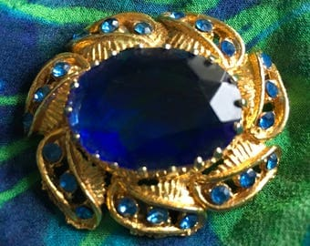 Gold tone large blue stone brooch