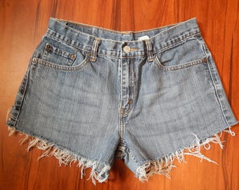 557 Distressed Levi's Mid Rise Shorts