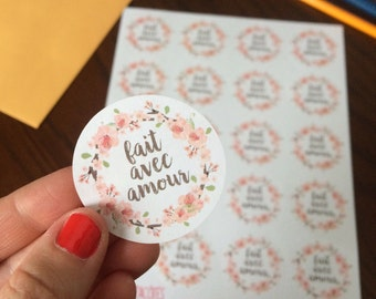 "Stickers ""Fait avec amour"" with flowers on white paper"