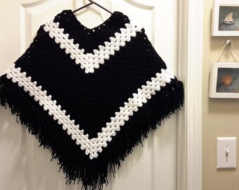 Woman's black and white poncho size small to medium