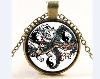 Dragon and Tiger bronze glass cabochon pendant with chain