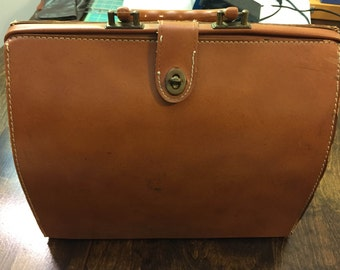 Beautiful vintage leather doctor bag with plastic handle