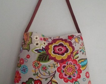 Large beige bag and big flowers and leather strap