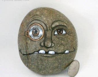 face on rock,Creepy face,Stone face, painted rock,Garden decor,funny rock face,creepy rock head,eye glass,fairy garden,monacle,smiling rock