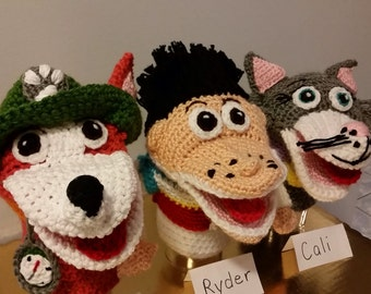 Crocheted paw patrol hand puppets ( 3 new) at 30.00 each.