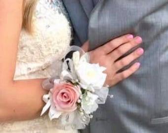 Matching rose wrist corsage and boutonnière set