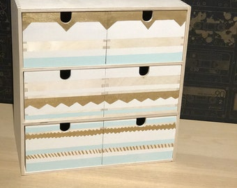 Small storage drawers in stripe