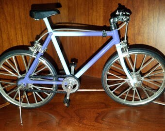 Miniature real working toy bicycle