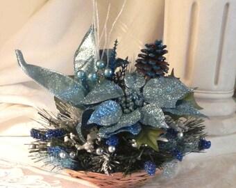 Low blue poinsetta basket