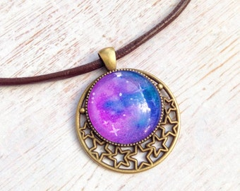 NEW Galaxy Art Nouveau pendant bright purple blue handpainted, bronze cameo with crystal cabochon and brown leather cord