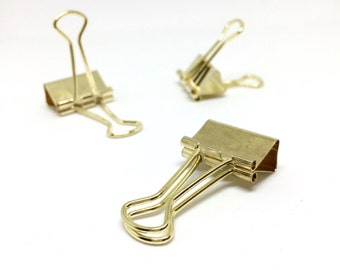 Gold coloured solid bulldog paper clips