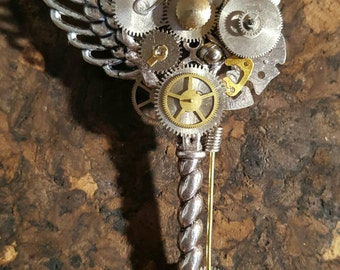 Steampunk key brooch with angel wing, vintage watch and clock parts