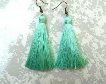 Mint tassel earrings.