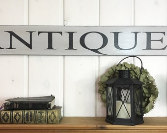 """Antiques sign 