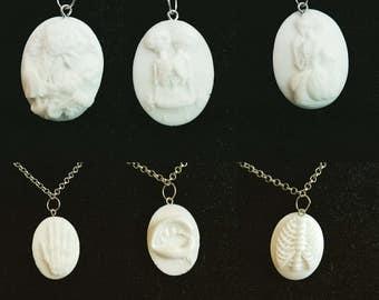 Gothic cameo/skeleton pendant
