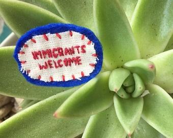 Immigrants Welcome badge
