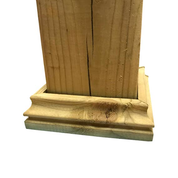 Pressure treated wood decorative post base for fence and