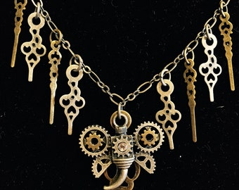 Mechanical winged creature necklace
