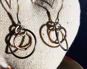 Offset ring drop earrings in silver and copper