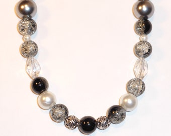 Silvers,whites, blacks and crystals