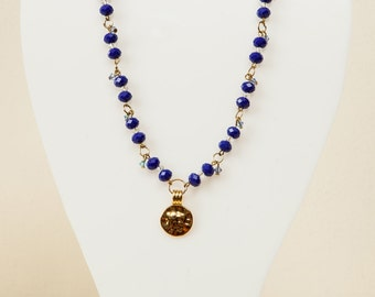Beautiful blue  and crystal beaded necklace with gold medallion.