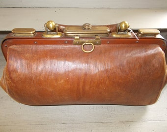 Superb traditional French Gladstone Bag, doctor's bag with brass accessories including handle ends, leather interior, sturdy, lovely.