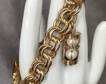 Monet gold plated bracelet with vintage 12KT hour glass charm marked imperial pearl
