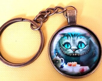 Cheshire Cat at Mad Hatter's Tea Party - Glass Dome Cabochon Keychain / Bag Charm Bronzed Effect