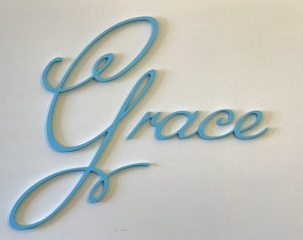 Fancy script Girls name for a bedroom or nursery